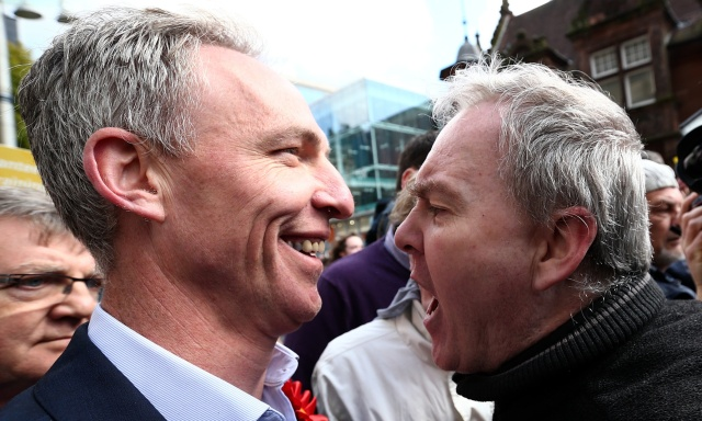 GLASGOW, SCOTLAND - MAY 04:  Jim Murphy (L), the leader of the Scottish Labour Party, is confronted by a protester as he campaigns with comedian Eddie Izzard on May 4, 2015 in Glasgow, Scotland. Campaigning is continuing by all parties throughout the United Kingdom ahead of the forthcoming general election.  (Photo by Carl Court/Getty Images)