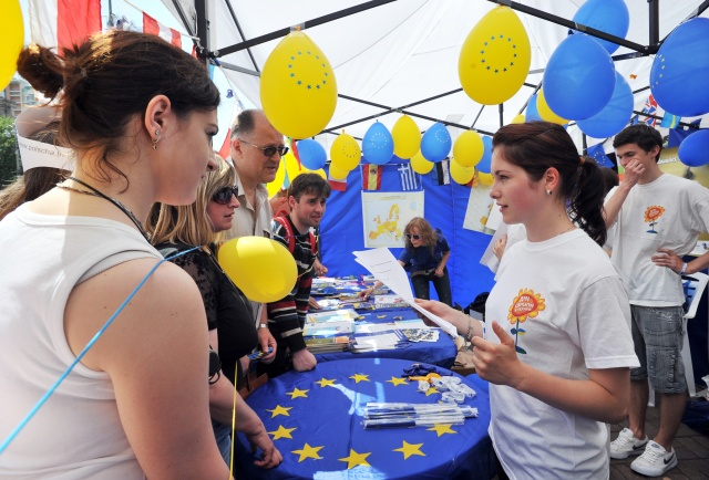 Activists give out information materials and souvenirs in the pavilion of  EU Delegation to Ukraine  during the Day of Europe in Kiev on May 18, 2013. PHOTO AFP © EU/NEIGHBOURHOOD INFO CENTRE
